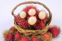Rambutan in basket white background. Rambutan in basket on white background Stock Photo
