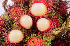 Rambutan in basket white background. Rambutan in basket on white background Stock Photos