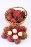 Rambutan in basket white background. Rambutan in basket on white background Stock Photography
