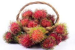 Rambutan in basket white background. Rambutan in basket on white background Royalty Free Stock Image