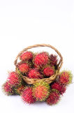 Rambutan in basket white background. Rambutan in basket on white background Royalty Free Stock Photos