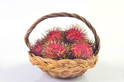 Rambutan in basket on white background. Rambutan in basket on a white background Stock Photos
