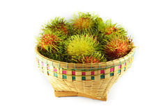 Rambutan in basket. A basket of rambutan on white background Stock Photography
