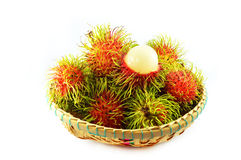Rambutan in basket. A basket of rambutan on white background Royalty Free Stock Photo