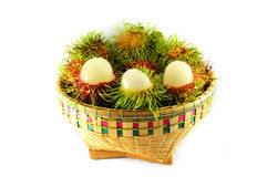 Rambutan in basket. A basket of rambutan on white background Royalty Free Stock Image