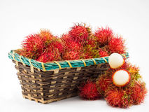 Rambutan in basket. On the white background Stock Photography