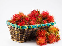 Rambutan in basket. On the white background Stock Image