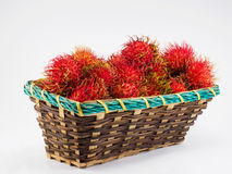 Rambutan in basket. On the white background Royalty Free Stock Photography