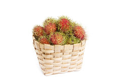 Rambutan in basket on white blackground. Isolated Royalty Free Stock Photo