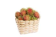 Rambutan in basket on white blackground Royalty Free Stock Photo