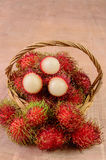 Rambutan in basket on wooden floors. Rambutan in basket on a wooden floors Stock Photography
