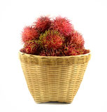 Rambutan on basket wooden. And white background Royalty Free Stock Images