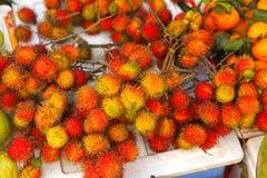 Rambutan berries fruit on vietnamese market. Rambutan berries fruit on vietnamese asian market Stock Photos
