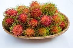 Rambutan in cestino Fotografie Stock