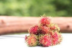 Rambutan. Closeup rambutans on wooden teble in Orchards Royalty Free Stock Photos