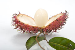 Rambutan, compositions of the son,White background. Fresh tropical level close-up Stock Images