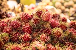 Rambutan on the counter market. Traditional t Rambutan on the counter market in Thailand Royalty Free Stock Image