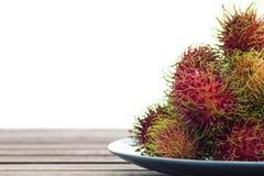 Rambutan in dish Stock Images