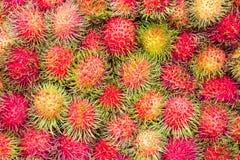 Rambutan fruit background. Fresh rambutan fruit in the market, Thailand Royalty Free Stock Photo