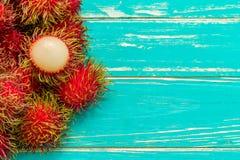 Rambutan Fruit Background / Rambutan Fruit / Rambutan Fruit on Wooden Background Stock Image