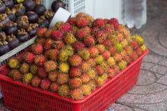 Rambutan fruit on street market. Rambutan fruit in box for sale on market Stock Photography