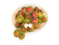 Rambutan fruit on white background. The rambutan fruit on white background Royalty Free Stock Image