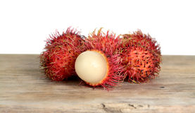 Rambutan fruit. On wooden table  isolated on white background Royalty Free Stock Photo