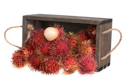 Rambutan fruit. On wooden table isolated on white background Stock Photos