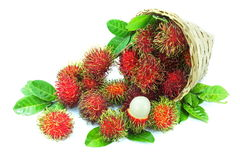 Rambutan fruits. In basket on white background Stock Photos