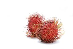 Rambutan fruits. (Nephelium lappaceum), isolated on white background, front one sharp, background one blurred Royalty Free Stock Images