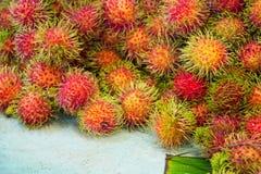 Rambutan fruits,. A lot of hairy Rambutan fruits, at a market Stock Photo