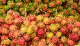 Rambutan fruits at a market in Mekong Delta. A lot of hairy rambutan fruits at a market in Mekong Delta, southern Vietnam Stock Photography