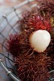 Rambutan fruits. On a rustic table Royalty Free Stock Photos