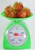 Rambutan on green weighting scale Stock Photography