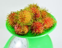 Rambutan on green weighting scale Royalty Free Stock Photos