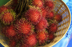 Rambutan or hairy fruit Stock Images