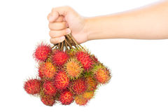Rambutan in hand. Isolated on white background Stock Photos