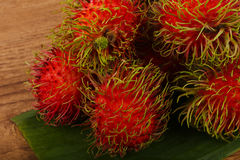 Rambutan heap. Fresh ripe sweet Rambutan heap - asian fruit Royalty Free Stock Photography