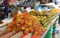 Rambutan, lat. Nephelium lappaceum at street market Stock Image