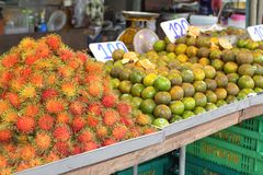 Rambutan, lat. Nephelium lappaceum at street market, Thailand, Krabi. Asian street stall full of fresh fruit Stock Photography