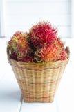 Rambutan. A lot of Rambutan in basket stock image