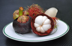 Rambutan and Mangosteen. Tropical fruit rambutan and mangosteen on plate Royalty Free Stock Photo