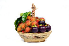 Rambutan and mangosteen in basket. Rambutan and mangosteen in basket on white background royalty free stock photography