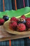 Rambutan and mangosteen fruits Stock Images