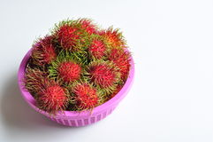 Rambutan. Many Rambutan in pink basket Royalty Free Stock Photo