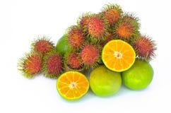 Rambutan med orange frukt Fotografering för Bildbyråer