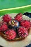 Rambutan och mangosteen Arkivfoton