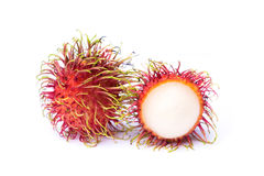Rambutan and one peel off rind on white background. S stock image