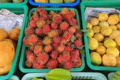 Rambutan op de markt Stock Fotografie