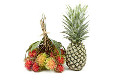 Rambutan and pineapple isolated on white background. Fresh rambutan and pineapple isolated on white background Royalty Free Stock Photos